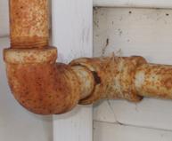 Rusty Pipes Cause Basement Water Leak Repair